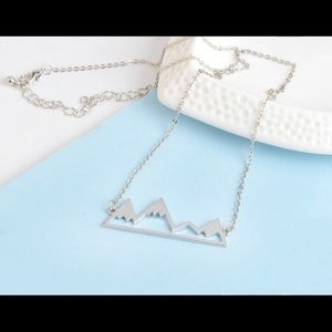Mountain necklace in silver brand new